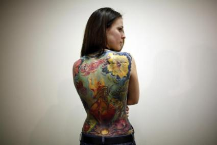 227679-a-woman-displays-her-tattoo-during-an-international-tattoo-exhibition-
